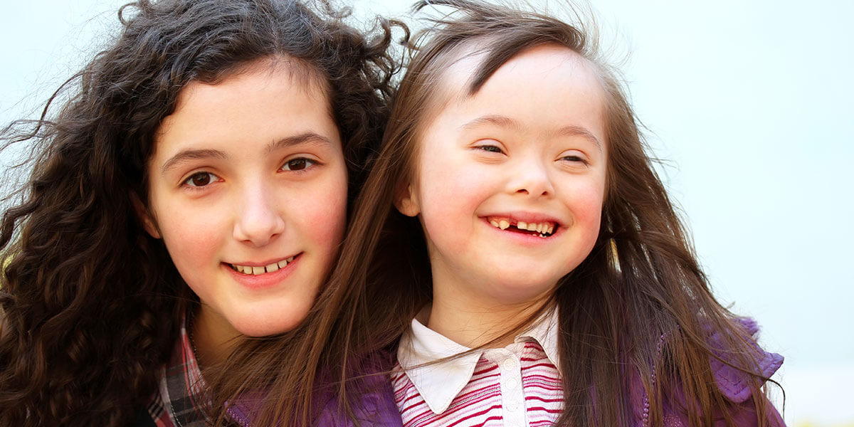 Two smiling young ladies